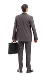 Full length portrait of a businessman with briefcase shot from b Royalty Free Stock Photography