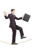Full length portrait of a businessman with briefcase walking on Stock Photo