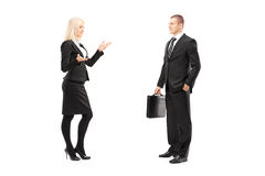 Full length portrait of a businessman and businesswoman talking Royalty Free Stock Photography
