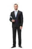 Full-length portrait of businessman with folder Stock Photos