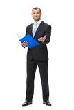 Full-length portrait of businessman with folder. Isolated on white. Concept of leadership and success royalty free stock photography