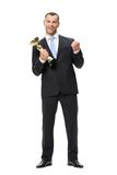 Full-length portrait of businessman with golden cup Royalty Free Stock Photography