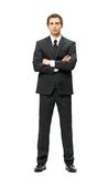 Full-length portrait of businessman with hands crossed Stock Photo