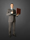 Full length portrait of businessman with laptop. Showing welldone Royalty Free Stock Photography