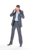 Full length portrait businessman with mobile phone Royalty Free Stock Photo