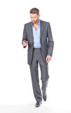 Full length portrait businessman with mobile phone Royalty Free Stock Image