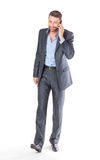 Full length portrait businessman with mobile phone Stock Photo