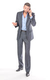 Full length portrait businessman with mobile phone Stock Photography