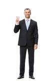 Full-length portrait of businessman peace gesturing Stock Image