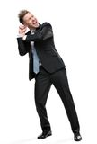 Full length portrait of businessman pushing something Royalty Free Stock Photo