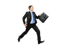 Full length portrait of a businessman running away Royalty Free Stock Photos