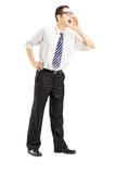 Full length portrait of a businessman shouting. Isolated on white background Stock Photos