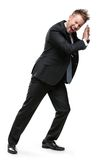 Full length portrait of businessman shoving something Royalty Free Stock Photography