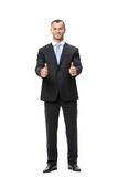 Full-length portrait of businessman thumbing up Royalty Free Stock Photography