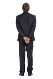 Full-length portrait of businessman with tied hands. Isolated on white. Concept of slavery and hard work Stock Photography