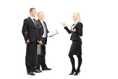 Full length portrait of businessmen and businesswoman having a c Royalty Free Stock Photos