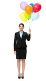 Full-length portrait of businesswoman with balloons Stock Photography
