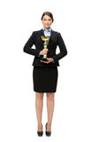 Full-length portrait of businesswoman with gold cup Stock Photography
