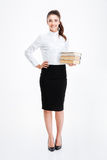 Full length portrait of a businesswoman holding books isolated Stock Photography