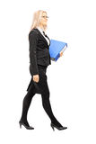 Full length portrait of businesswoman holding a folder Royalty Free Stock Images