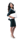 Full length portrait of a businesswoman with laptop Royalty Free Stock Images