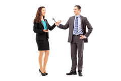 Full length portrait of a businesswoman and male reporter having Royalty Free Stock Photography