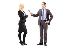 Full length portrait of a businesswoman and male reporter having Stock Image