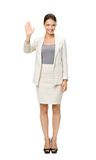 Full-length portrait of businesswoman palm gesturing Stock Photo