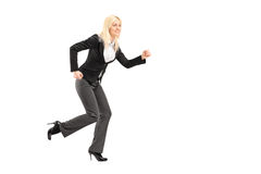 Full length portrait of a businesswoman running Stock Photography