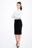 Full length portrait of a businesswoman standing with arms folded Royalty Free Stock Photography