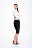 Full length portrait of a businesswoman standing with arms folded Royalty Free Stock Image