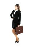 Full length portrait of a businesswoman walking with a briefcase Stock Photos