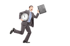 Full length portrait of a busy businessperson running late Royalty Free Stock Image