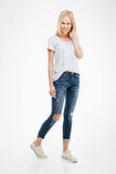 Full length portrait of a casual attractive blonde woman standing Royalty Free Stock Photo