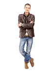 Full length portrait of a casual guy posing. Isolated on white background royalty free stock images