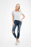 Full length portrait of a casual happy blonde woman standing Stock Photos