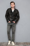 Full length portrait of a casual man in leather jacket Stock Photography