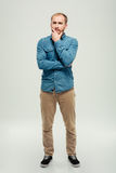 Full length portrait of a casual pensive man Royalty Free Stock Image