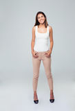 Full length portrait of a casual smiling woman Stock Photo