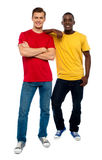 Full length portrait of casual young dudes. Posing in style royalty free stock image