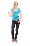 Full length portrait of casual young girl giving thumb up Royalty Free Stock Image