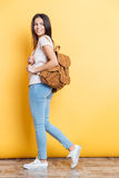 Full length portrait of a charming woman with backpack Royalty Free Stock Photography