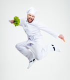Full length portrait of a cheerful chef cook dancing. Isolated on a white background Stock Photo