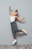 Full length portrait of a cheerful cute woman jumping Royalty Free Stock Photo