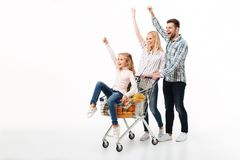 Full length portrait of a cheerful family royalty free stock photography