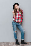 Full length portrait of a cheerful girl in plaid shirt Royalty Free Stock Photos