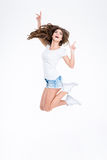 Full length portrait of a cheerful woman jumping Stock Image
