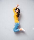 Full length portrait of a cheerful woman jumping Royalty Free Stock Images