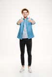 Full length portrait cheerful young man showing thumbs up Royalty Free Stock Photos