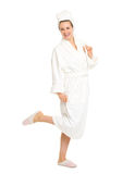 Full length portrait of cheerful woman in bathrobe Royalty Free Stock Photo